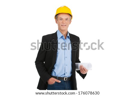 adult foreman wearing yellow hat. professional builder keeping hands in pocket - stock photo