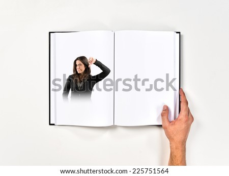 Adult girl doing a bad signal printed on book - stock photo