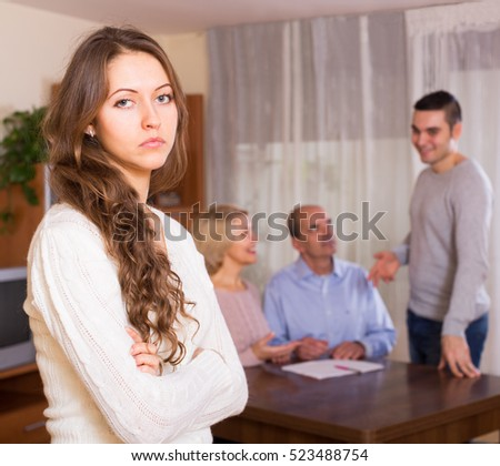 Adult girl with injured look after family quarrel indoor