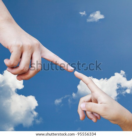 Adult hand and children hand against the sky - stock photo