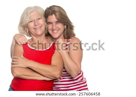 Adult hispanic woman hugging her older mother isolated on white - stock photo