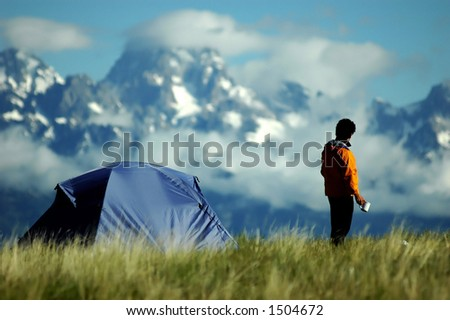 adult male gazing at stunning mountain vista - stock photo
