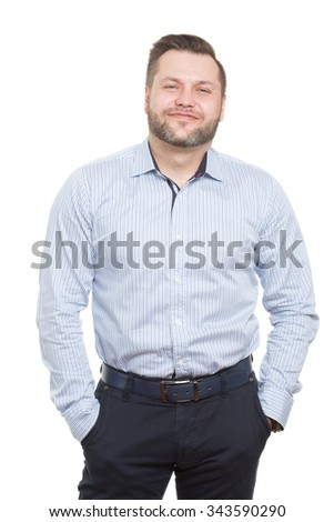 adult male with a beard. isolated white background. hands in his pockets. distrust posture