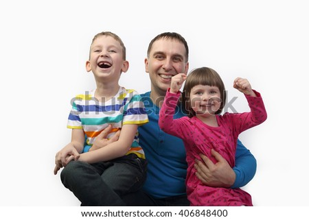 Adult male with little children portrait on light gray background - father, son and daughter - family relations and happiness concept - stock photo