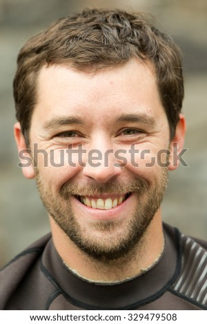 Adult Man Face Close Up Wearing Neoprene Wet Suit - stock photo