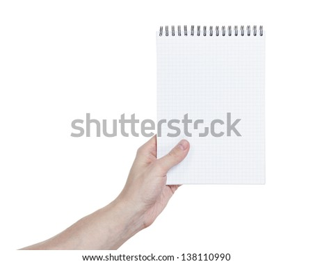 adult man hand holding notebook on a spring with blank page to write something, isolated - stock photo