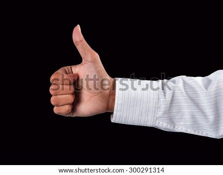 adult man hand thumb up, on black background - stock photo