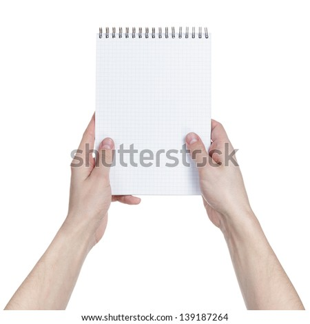 adult man hands holding notebook on a spring with blank page to write something, isolated