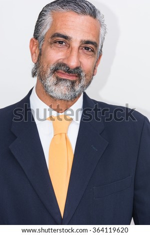 Adult man, mature, in suits. Bearded, grizzled, he thinks, deep in thought. Facial expressions, making faces. - stock photo