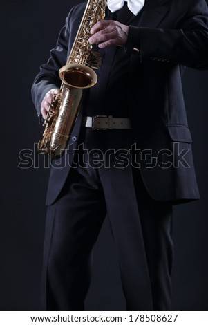 Adult man playing the saxophone