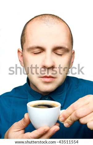 Adult man relaxing with a cup of coffee isolated on white background