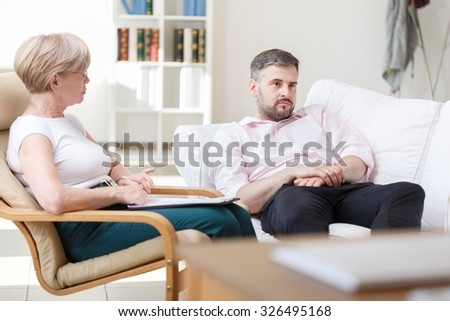 Adult man telling about his problems during psychotherapy session