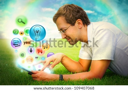 Adult man using his tablet computer to do his tasks everywhere