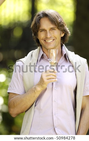 Adult man with glass of champagne - stock photo