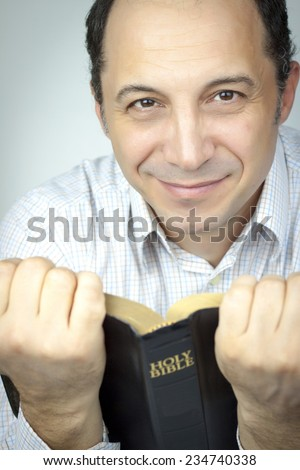 Adult Man With Glasses Reading Holy Bible - stock photo