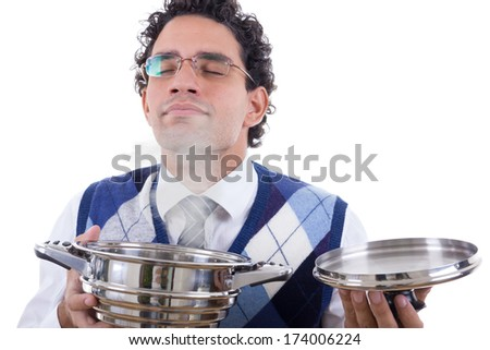 adult man  with glasses smelling delicious lunch from pot with steam - stock photo