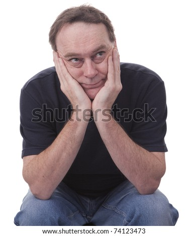 adult man with head in hands against a white background - stock photo