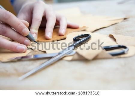 Adult Man Working In A Shoe Factory - stock photo