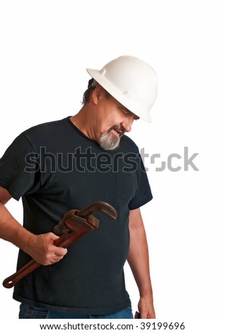 Adult plumber checks his work for leaks before quitting. - stock photo