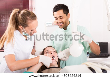 adult russian woman patient checking the teeth an digital xray