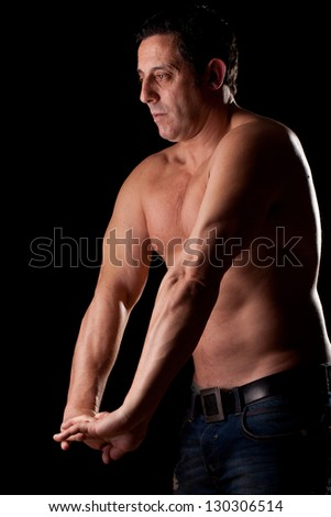 adult stem naked, pose with a sportsman - stock photo