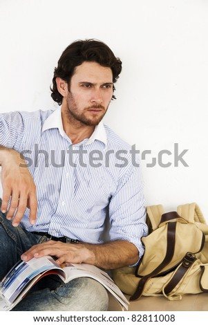 adult student with rucksack and books - stock photo