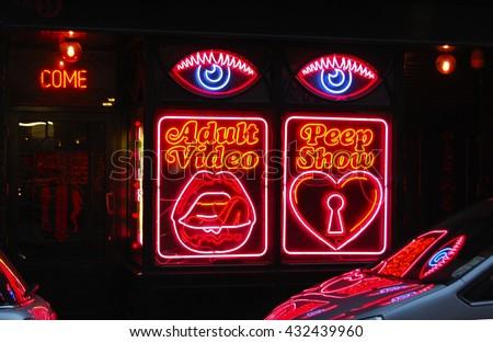 Adult video  and peep show neon sign in Soho London-AUGUST 30 2014,LONDON ,UK