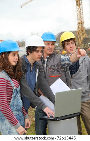 Adult with group of teenagers in professional training - stock photo