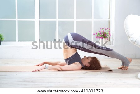 Adult woman doing fitness exercises at home. Senior woman do stretching exercises. Mature woman doing yoga poses.