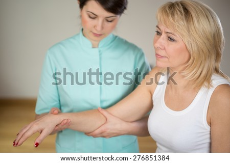 Adult woman during rehabilitation in physiotherapist's office - stock photo