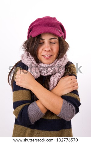 Adult woman freezing in the cold, isolated on white background.