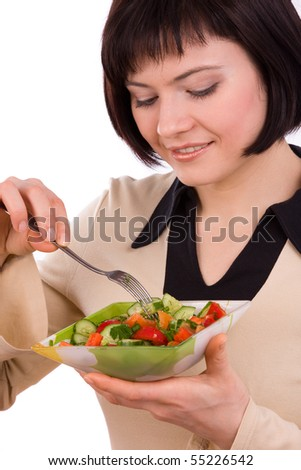 Adult woman holding plate with healthy salad. Portrait of young happy female eating salad