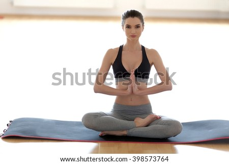 Adult woman in yoga position. Natural light. Shallow DOF. - stock photo