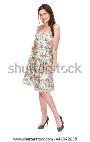 Adult woman posing in bright summer dress, isolated on white
