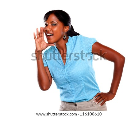 Adult woman screaming and looking at you on blue blouse against white background - stock photo