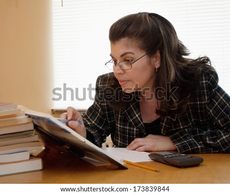 Adult woman studying and keeping up her skill with the market - stock photo