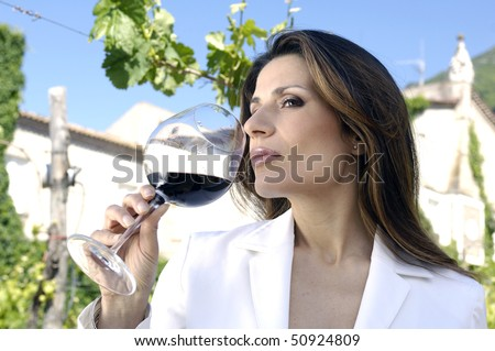 Adult woman tasting wine