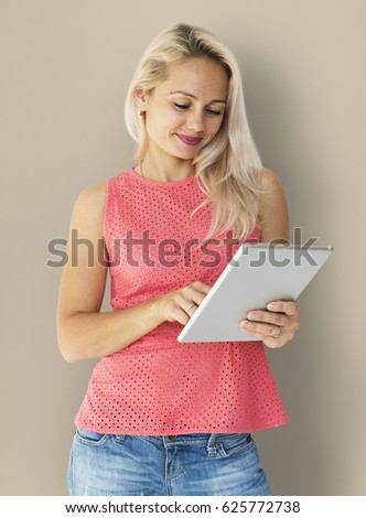 Adult Woman Using Digital Tablet Studio