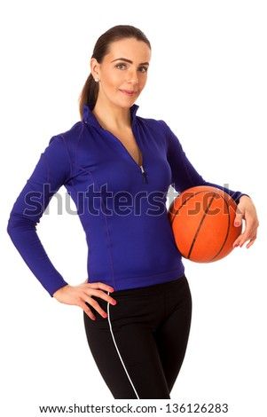 Adult woman with basketball. Studio shot over white.