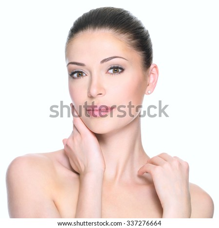 Adult woman with beautiful face - isolated on white. Skin care concept. - stock photo