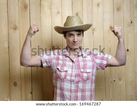 adult woman with cowboy hat showing stung muscles