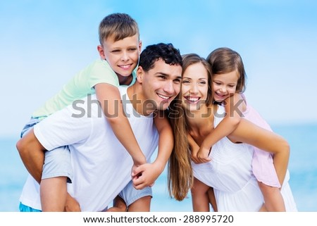 Adults, back, beach. - stock photo