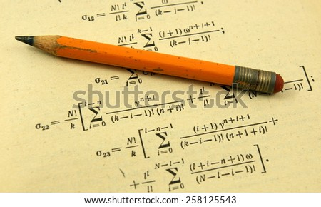 Advanced mathematics (maths): book and pencil in vintage style