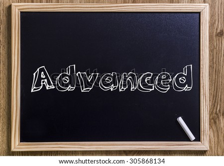 Advanced - New chalkboard with outlined text - on wood - stock photo