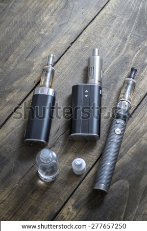 Advanced personal vaporizer or e-cigarette, close up - stock photo