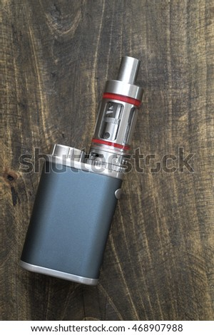 Advanced vaping device, e-cigarette on the  table