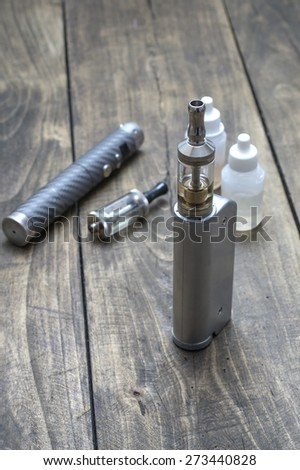 advanced vaping device on the table, e-cigarette - stock photo