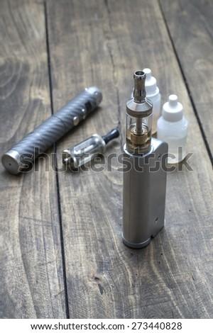 advanced vaping device on the table, e-cigarette - stock photo