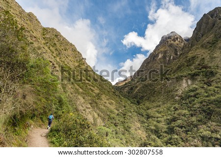 Advanture travellers treking pass The Dead woman pass on Inca Trail, Machu Picchu, Cusco, Peru