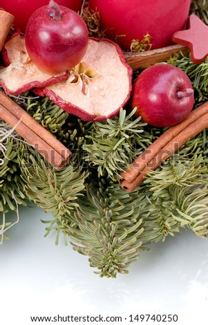 advent and christmas decoration with fir cone